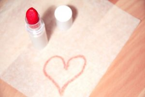 red-lipstick-on-table-and-heart-on-napkin