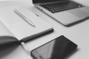 black-and-white-image-of-mobile-phone-and-notebook