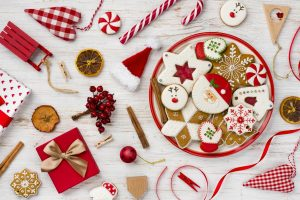 Traditional christmas gingerbread, toys and decor isolated on wooden background